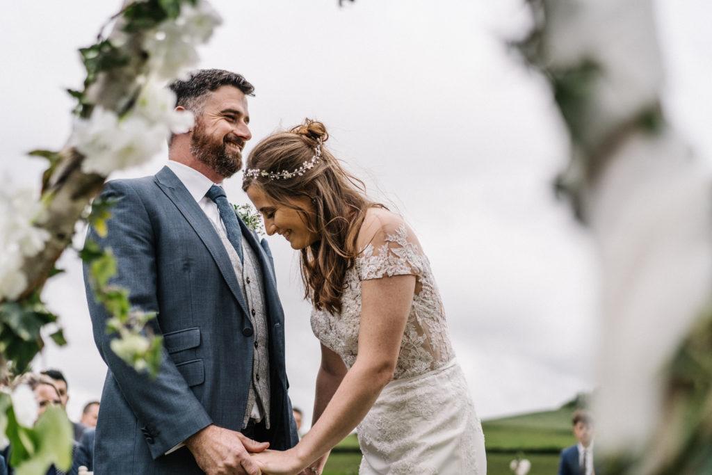 Celebrant tipi wedding outdoor ceremony laughing