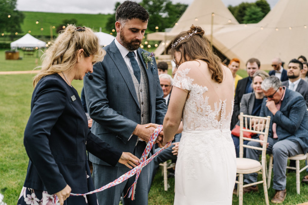 Celebrant tie the knot hand fasting tipi wedding