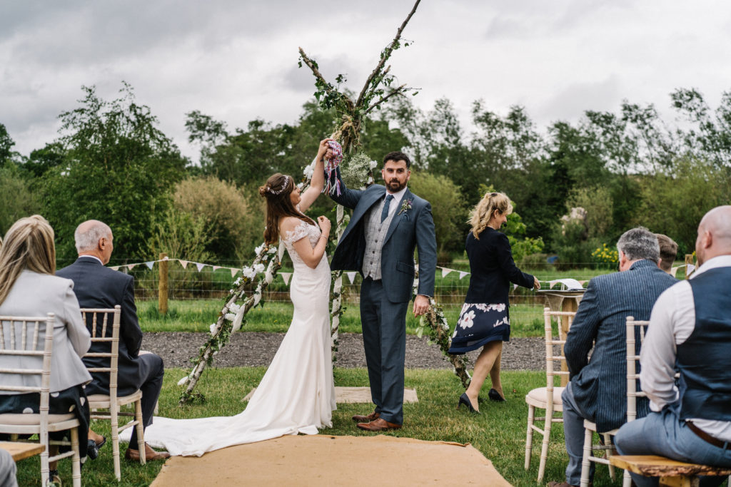 relaxed outdoor celebrant wedding Justine Wykerd Alcott Just Celebrations hand fasting tie the knot